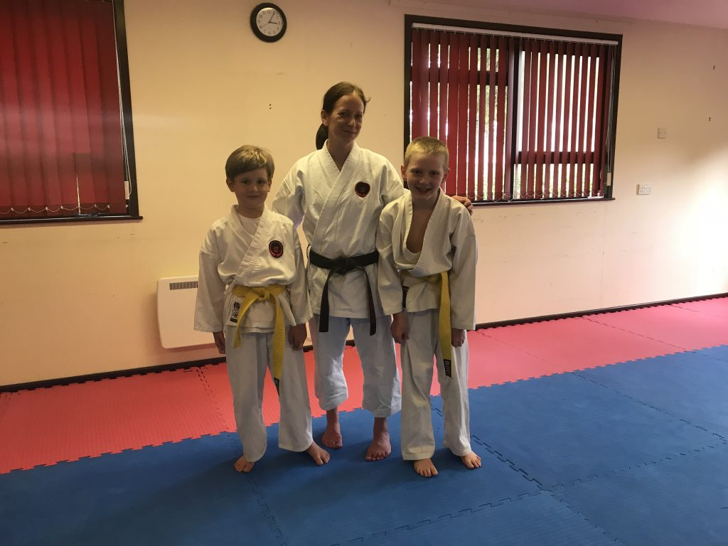 Junior students receiving their yellow belts